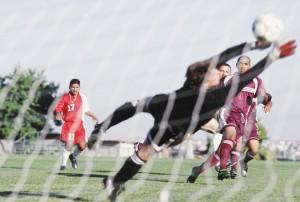 Soccer Goalie Diving for Ball